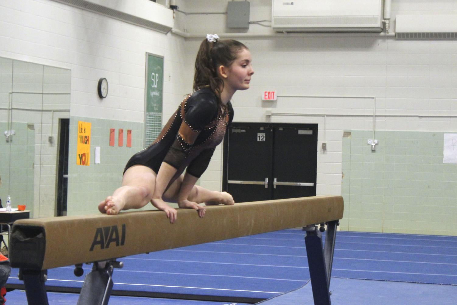 Sophomore Rachel Stein begins her routine on the beam Dec. 11 at their home meet against Richfield. The Park Gymnastics' team has begun strength training once a week to help them develop their skills in preparation for future meets.