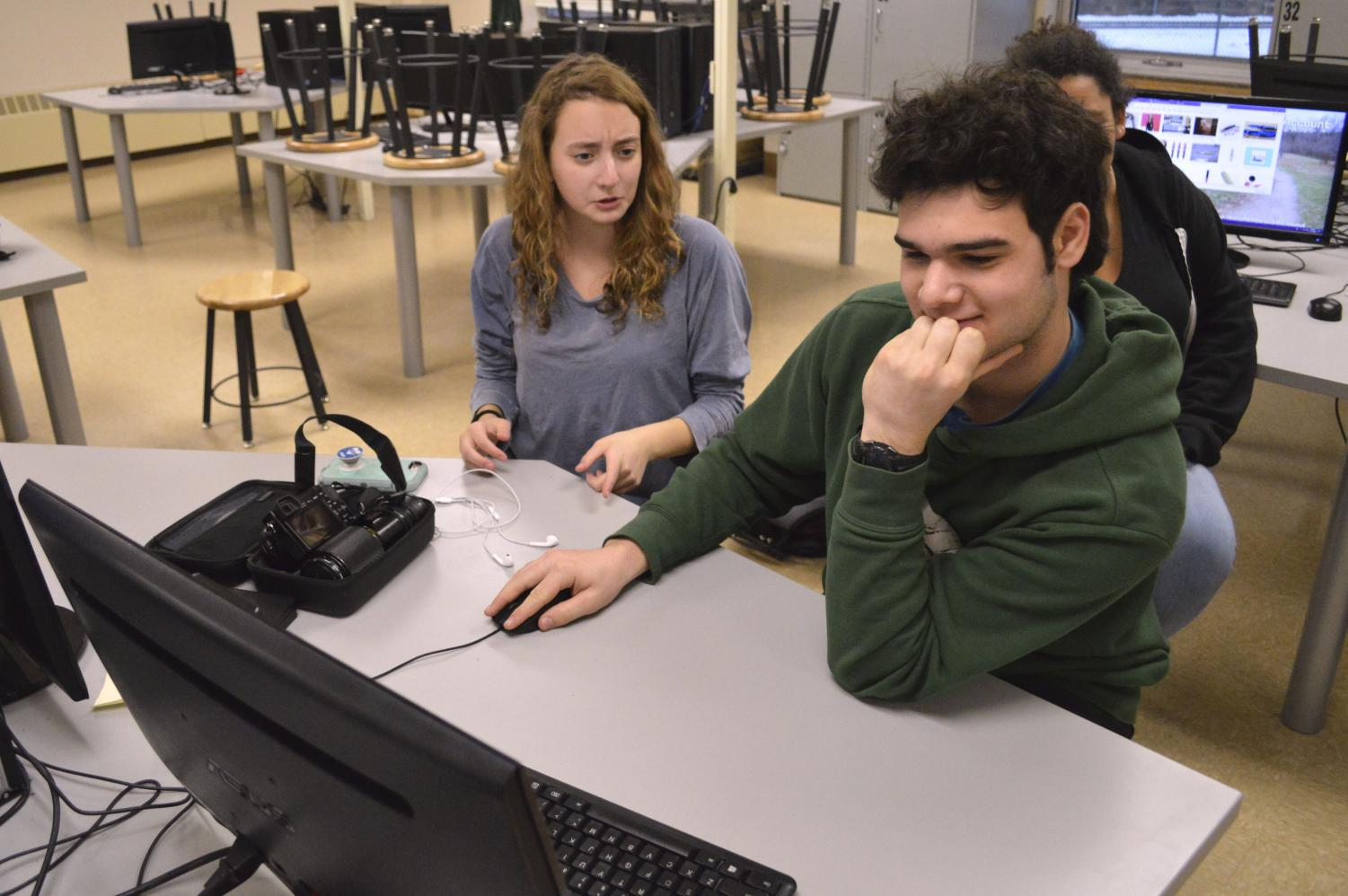 Sophomore Julia Salita and junior David Prohofsky discuss plans for a robot during practice Dec. 13. The team is preparing for the 2018-19 season which will begin in January.