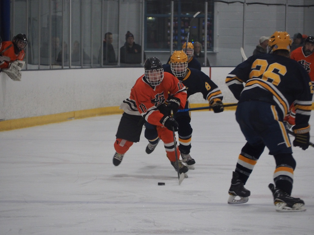 Senior+Tim+Collins+skates+around+sophomore+Joseph+Workman.+Park+has+won+two+of+their+conference+games+beating+Bloomington+Kennedy+Jan.+24+and+Chanhassen+Jan.+19.+This+leaves+Park%27s+conference+at+2-1-0.