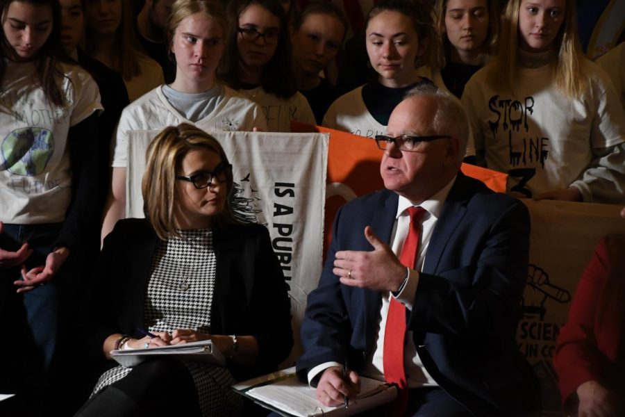 Minnesota+Governor+Tim+Walz+speaks+to+a+room+filled+with+students.+Walz+and+Lutinnent+Governor+Flanagan+addressed+climate+change+and+the+policies+in+which+they+wish+to+enact+throughout+their+term.+