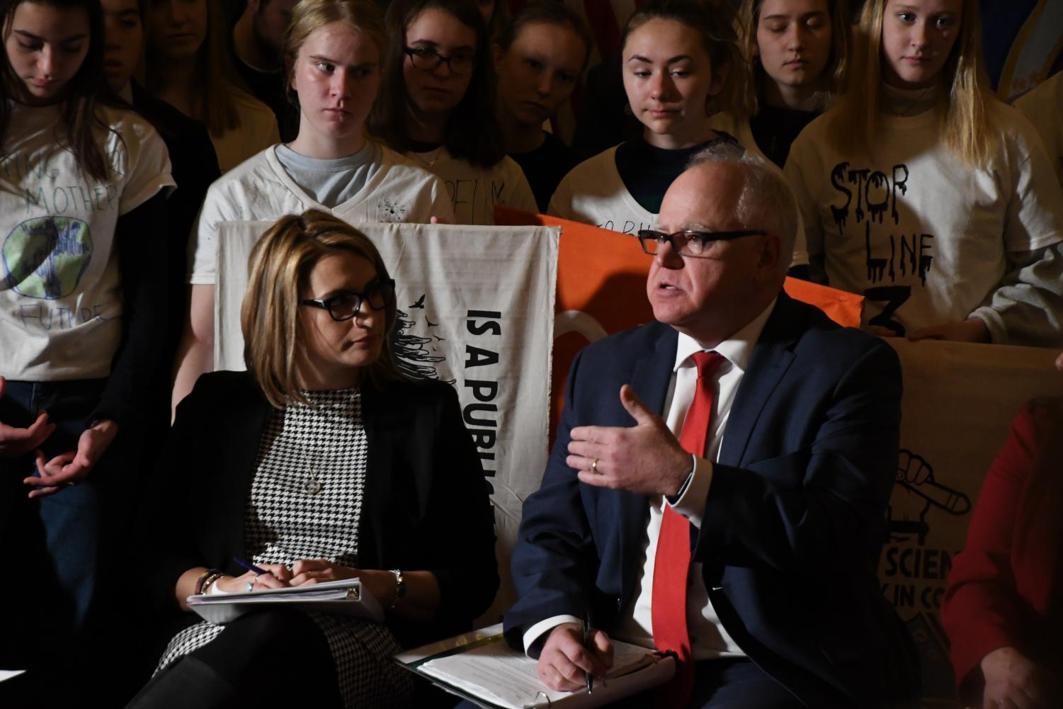 Minnesota Governor Tim Walz speaks to a room filled with students. Walz and Lutinnent Governor Flanagan addressed climate change and the policies in which they wish to enact throughout their term.