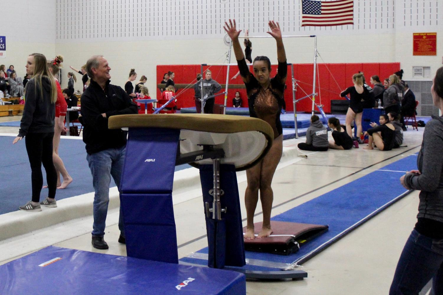 Sophomore Olivia Krueger jumps on the springboard to perform her vault routine. Park gymnastics competed at Henry Sibley High School Jan. 19.