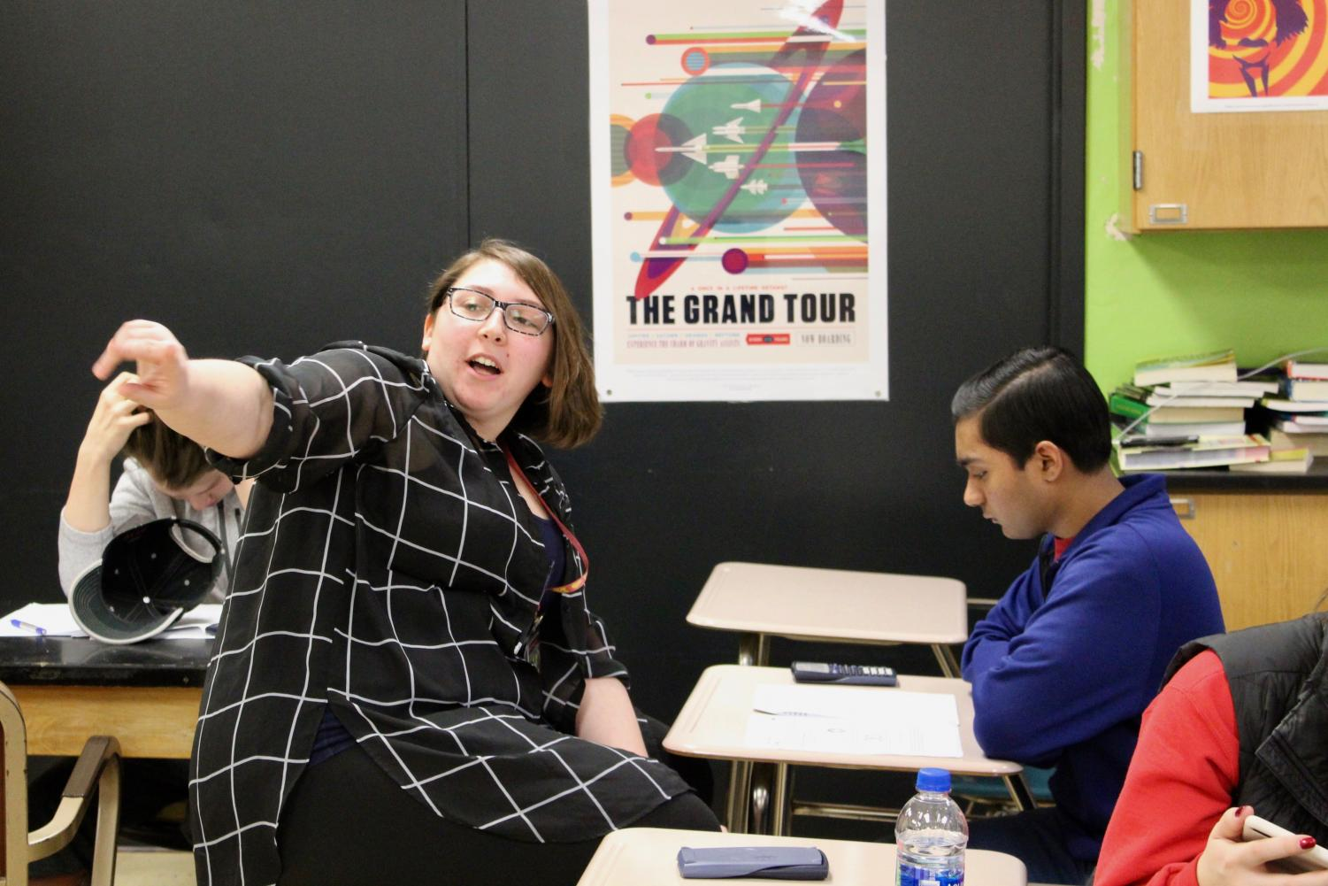 Student teacher Samantha Kamal explains a physics problem to senior Anand Datt Jan. 14. Kamal will be helping out around the physics classes.