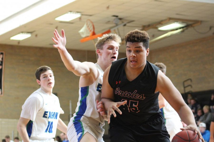 Senior Anthony Rayson uses his body to dribble past his defender. Park played Eagan Jan. 19 and won 80-54.
