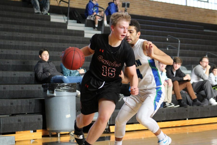 Senior Jacob Houts drives baseline to the basket for a layup. Houts had 13 points during the game against Eagan.