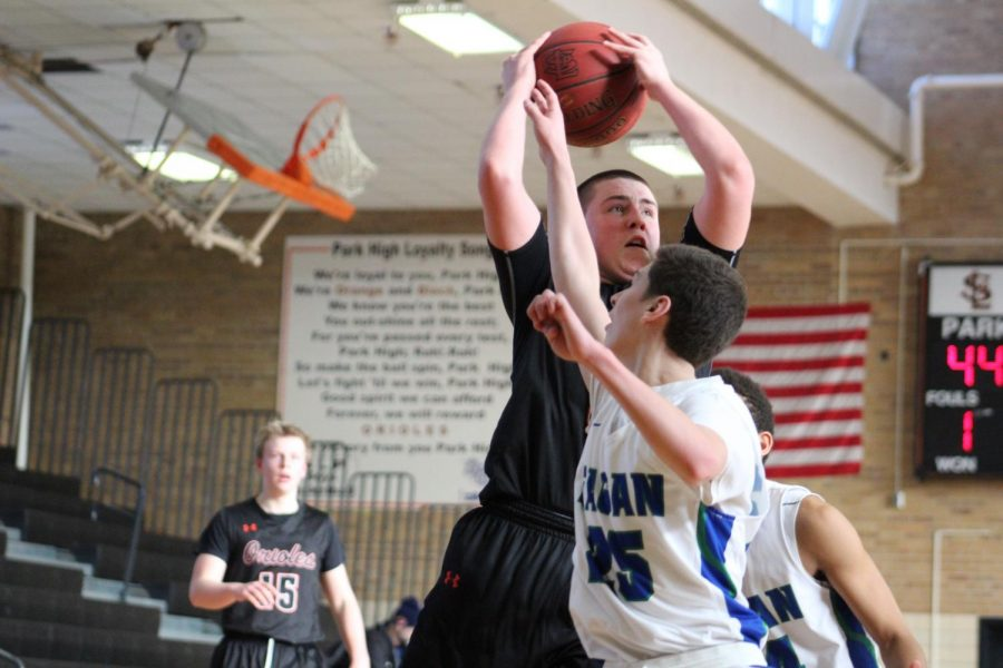 Junior Cole Ewald uses his strength to go up for a layup against Eagan player Cam House. Park's record is 7-6-0.