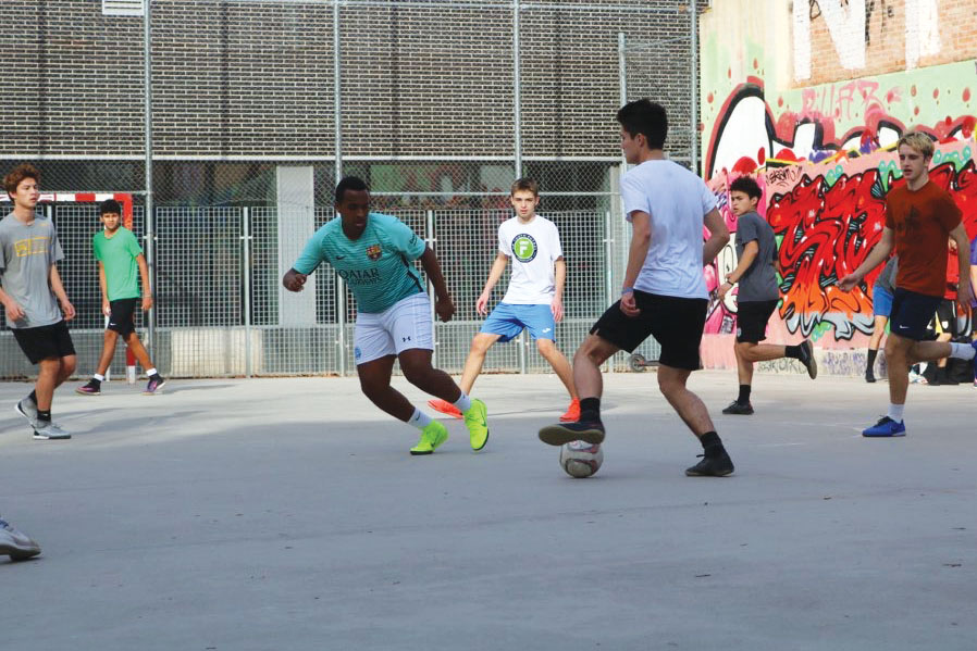 Senior Lioul Minas and Junior Nick Riley face off during a soccer practice during their time in Barcelona.