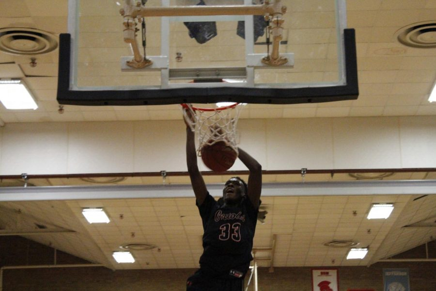 Sophomore Paris Johnson dunks the basketball to score two points for Park. The boys' basketball team's next game is against Richfield At 7 p.m. Jan. 17 at Park High School.