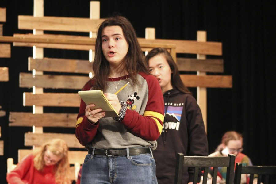 Senior Morgana Obredofer takes notes while rehearsing for 'The Amish Project'. The cast did thorough research on their characters and the tragedy that the play is based on so that they could accurately portray the story.