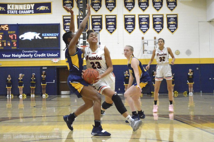 Sophomore Reagan Alexander prepares to shoot a lay up while being closely guarded. Park won 62-59 with a three point shot made by Shayla Miller in the last five seconds of their game against Bloomington Kennedy.