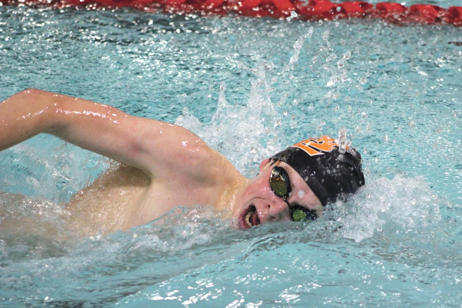 Ben St. Clair places third in the 200-yard freestyle during the meet against Benilde. They faced off at the St. Louis Park Middle School and came away with the win, beating Benilde by four points. The team's next meet is at 6 p.m. Jan. 17 at the high school against Robbinsdale Cooper.