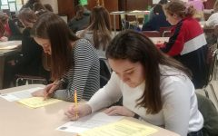 DECA begins competition through examination