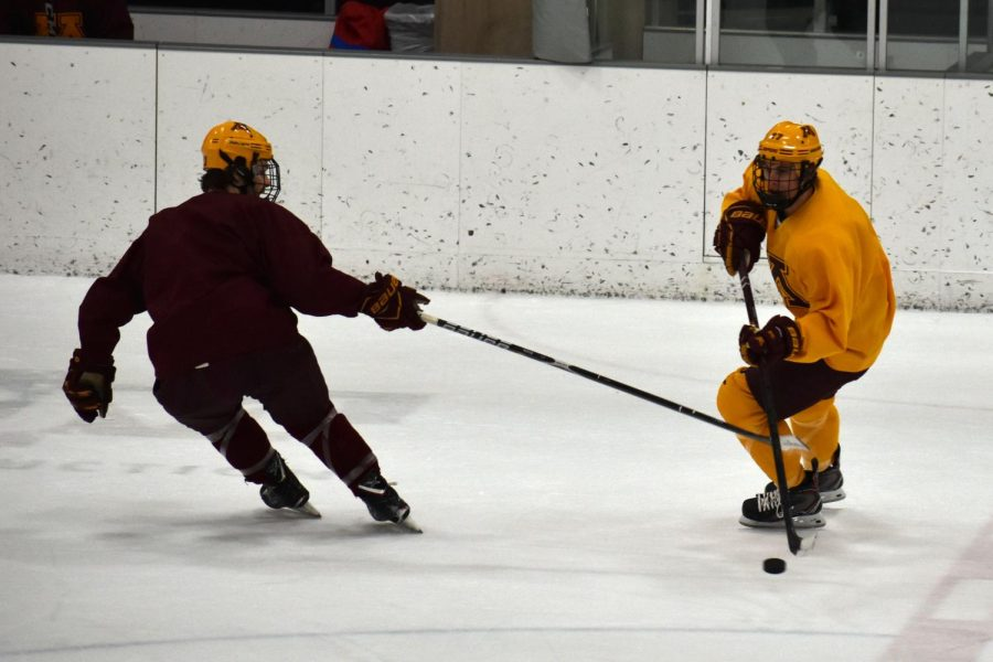 The maroon team tries to take the puck back from team gold during their hour long practice Jan. 14 at the ROC.