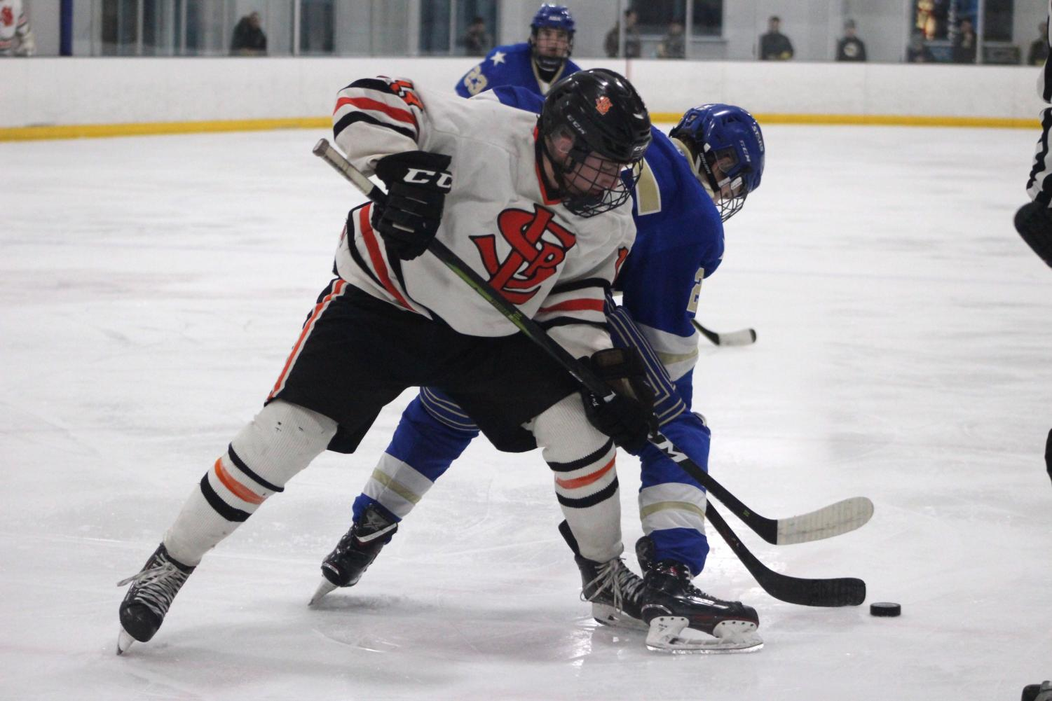 Sophmore Jack Wandmacher challenges Holy Angels player for the puck. The Park boys' hockey team played against Academy of Holy Angels 7 p.m. Jan. 15 at the Rec Center.