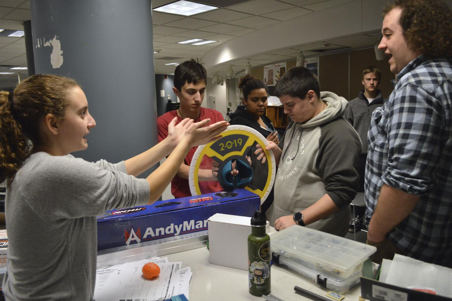 Sophomore robotics member Julia Salita discusses different ways to assemble materials with her fellow team members during a meeting Jan. 7. According to captain Anthony David, the robot has to be finished by Feb. 19 in order to compete in the Destination: Deep Space challenge.