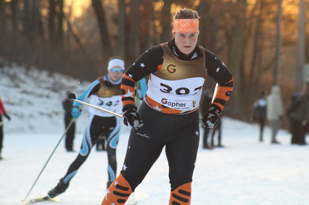 Sophomore Ivy Houts skis into the finish line of the meet Jan. 10 at Theodore Wirth Park. Girls' varsity placed third out of nine teams.