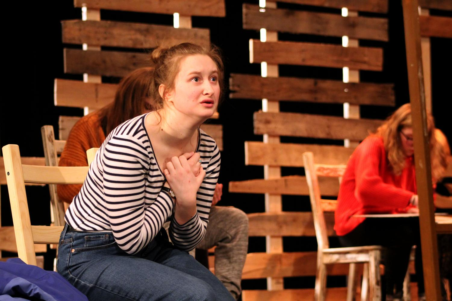 In preparation for the play sophomore Emily Turnquist delivers an emotional monologue at practice Dec. 11. After the performance the cast and crew allowed for questions from the audience on the making of the play.