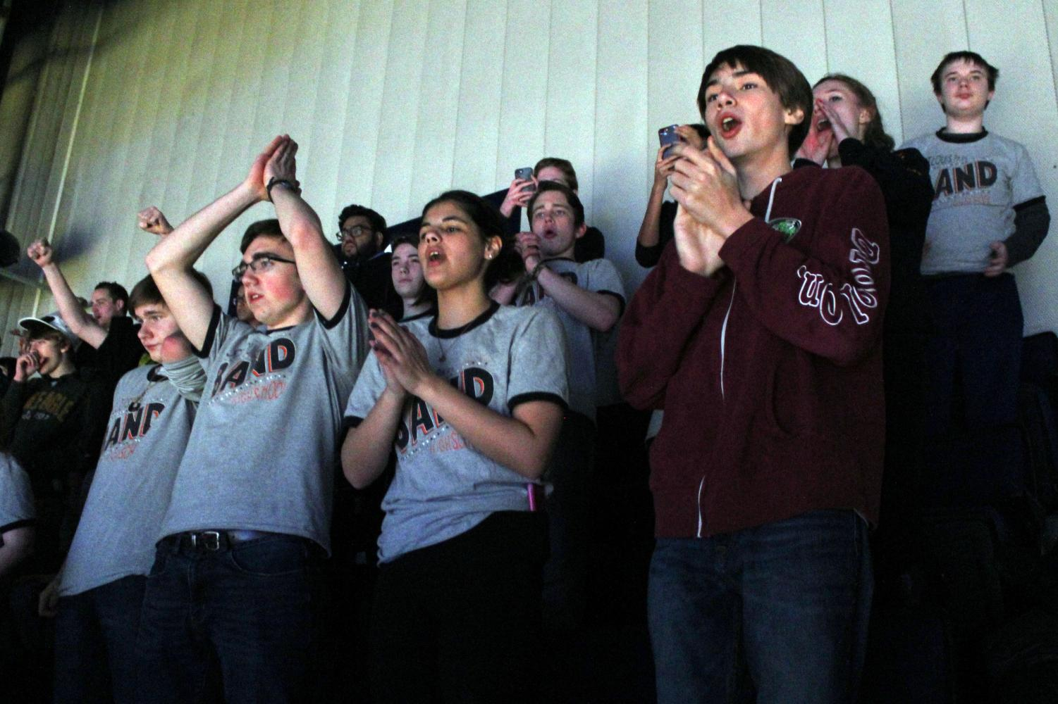 Freshman Harris Keekley and juniors Shaqued Ben-Harush and Brandon Wetterlin cheer at the Timberwolves game Jan. 11. About 50 students from Park bands performed before the game and then attended the game afterwards.