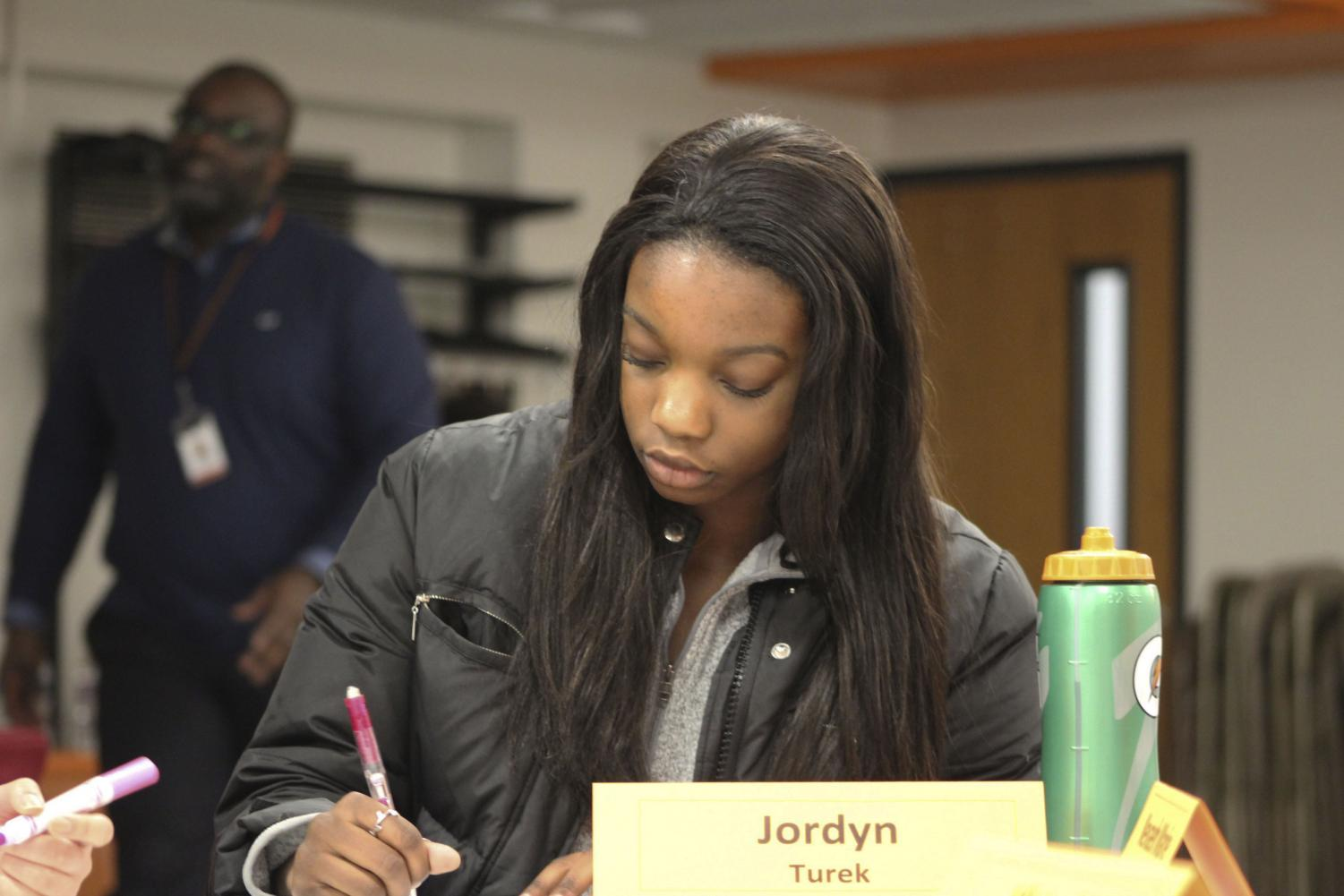 Junior Jordyn Turek writes down her opinions about the school starting time. The youth Panel met during the day Jan. 16 at SLP high school.