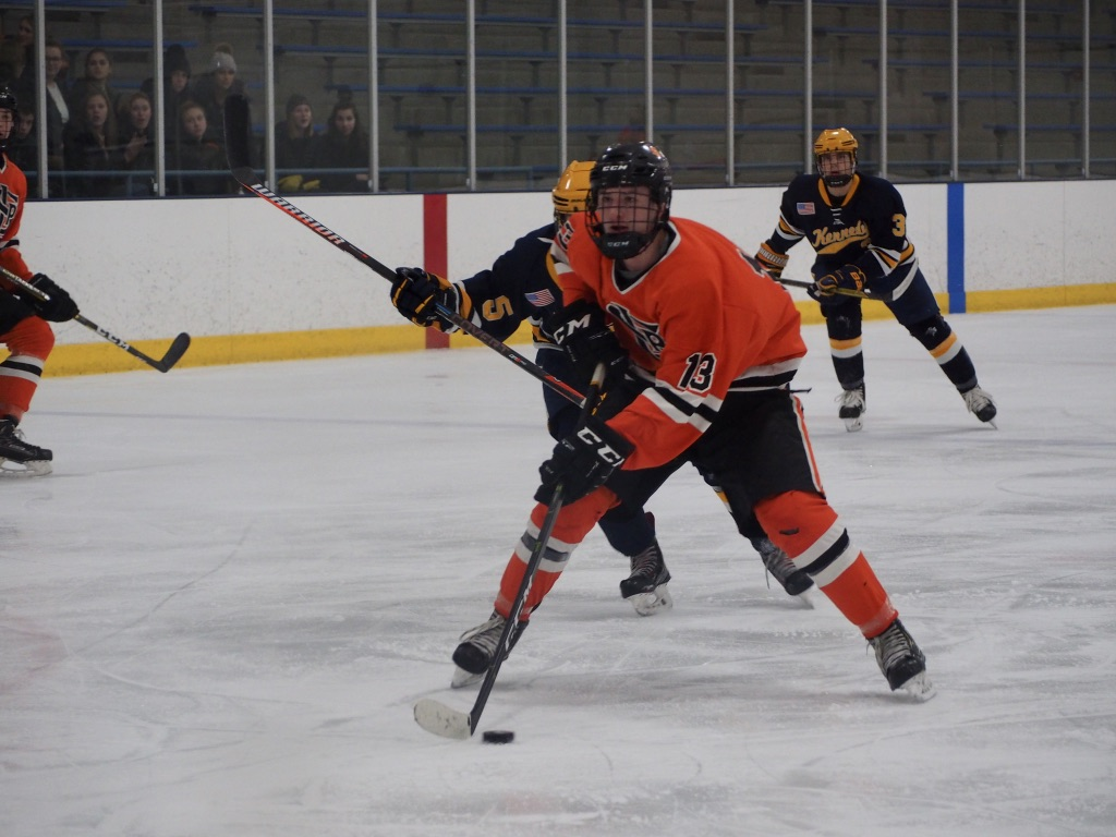 Sophomore+Jack+Wandmacher+passes+Bloomington+Kennedy+freshman+Logan+Dosan+before+shooting+the+puck.+Wandmacher+scored+Park%27s+first+goal+12+minutes+into+the+game+and+assisted+the+last+goal+against+Kennedy+Jan.+24.++