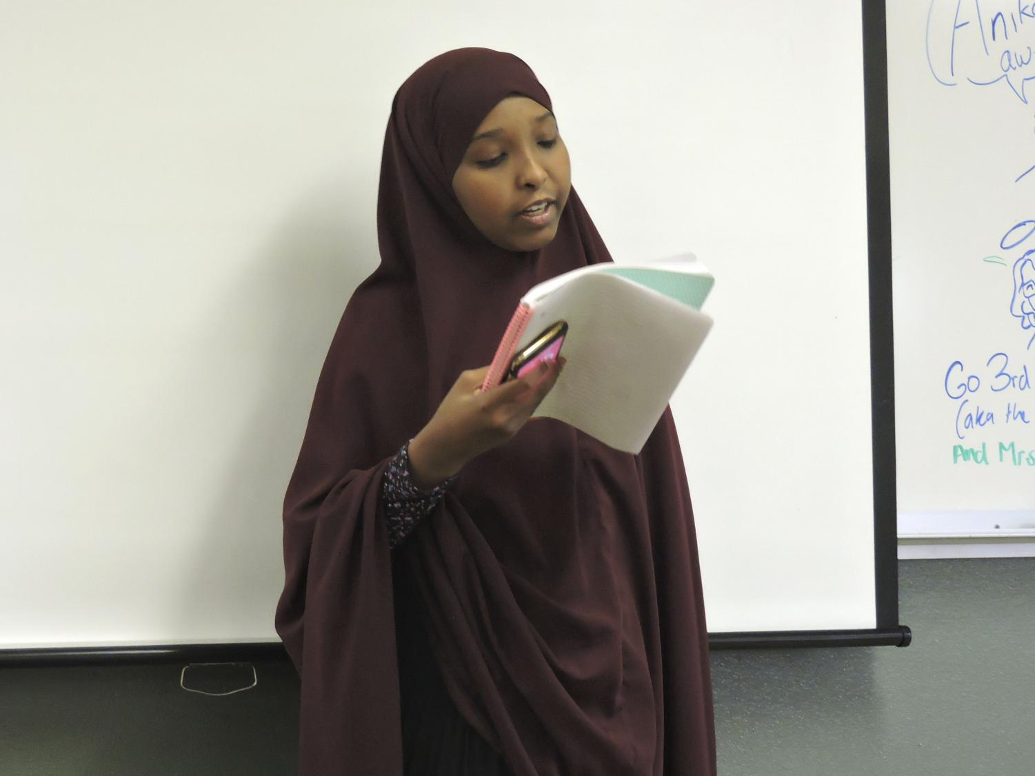 Freshman Ilhan Abdi reads aloud a poem she wrote for a poetry slam. 36 Arts meets Tuesday's before school according to advisor Christoph Nordmark.