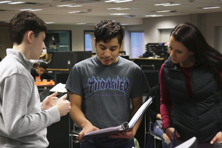 Senior project manager Christian Vega Celis works with a team member and an adult mentor during ACE club meeting. ACE meets Thursdays after school in C250A.