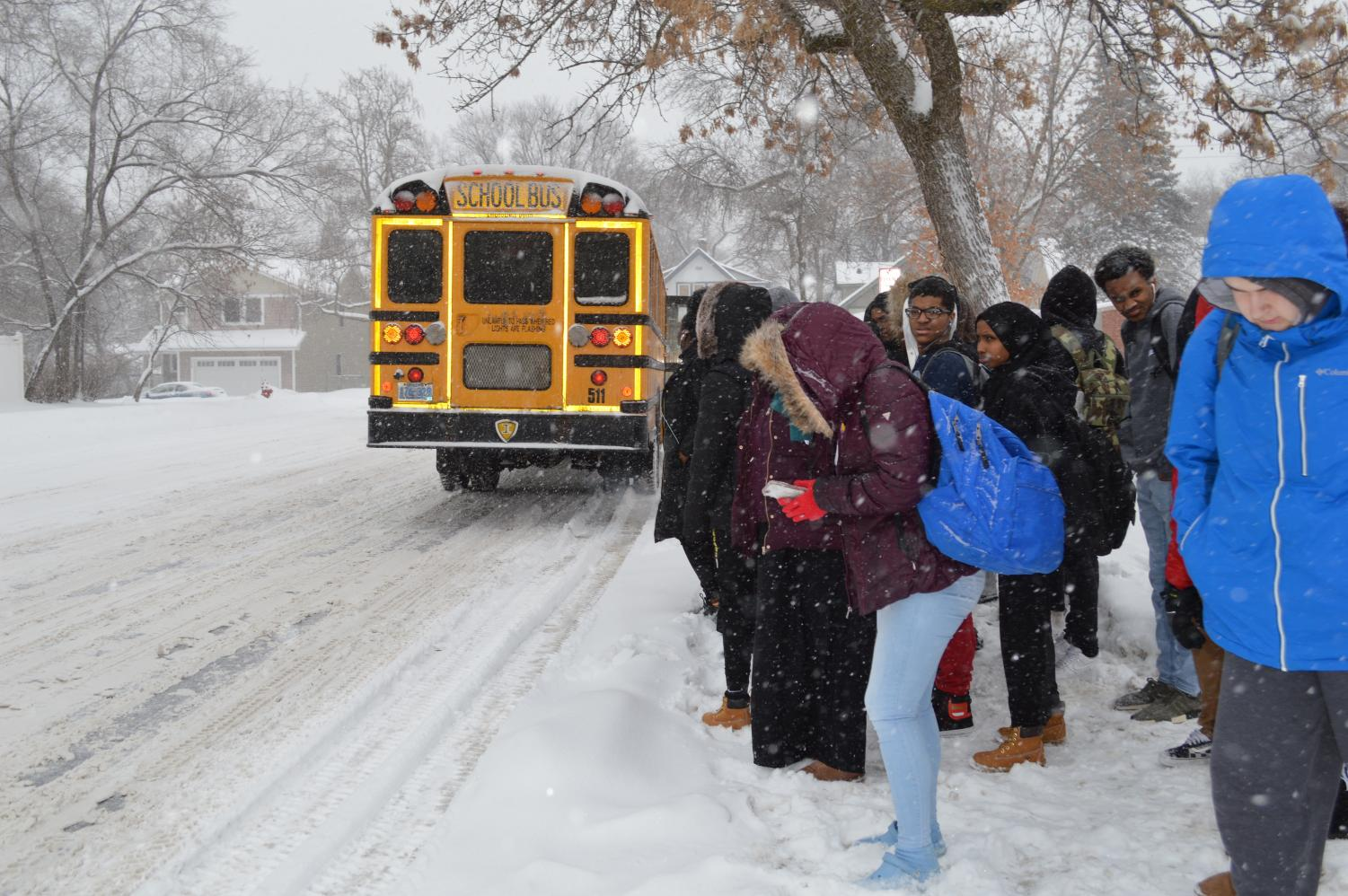 Students wait outside for their school bus after the early dismissal at 2:10 p.m. Feb. 7. St. Louis Park Public Schools will be closed Feb. 20 due to the forecasted snowstorm.