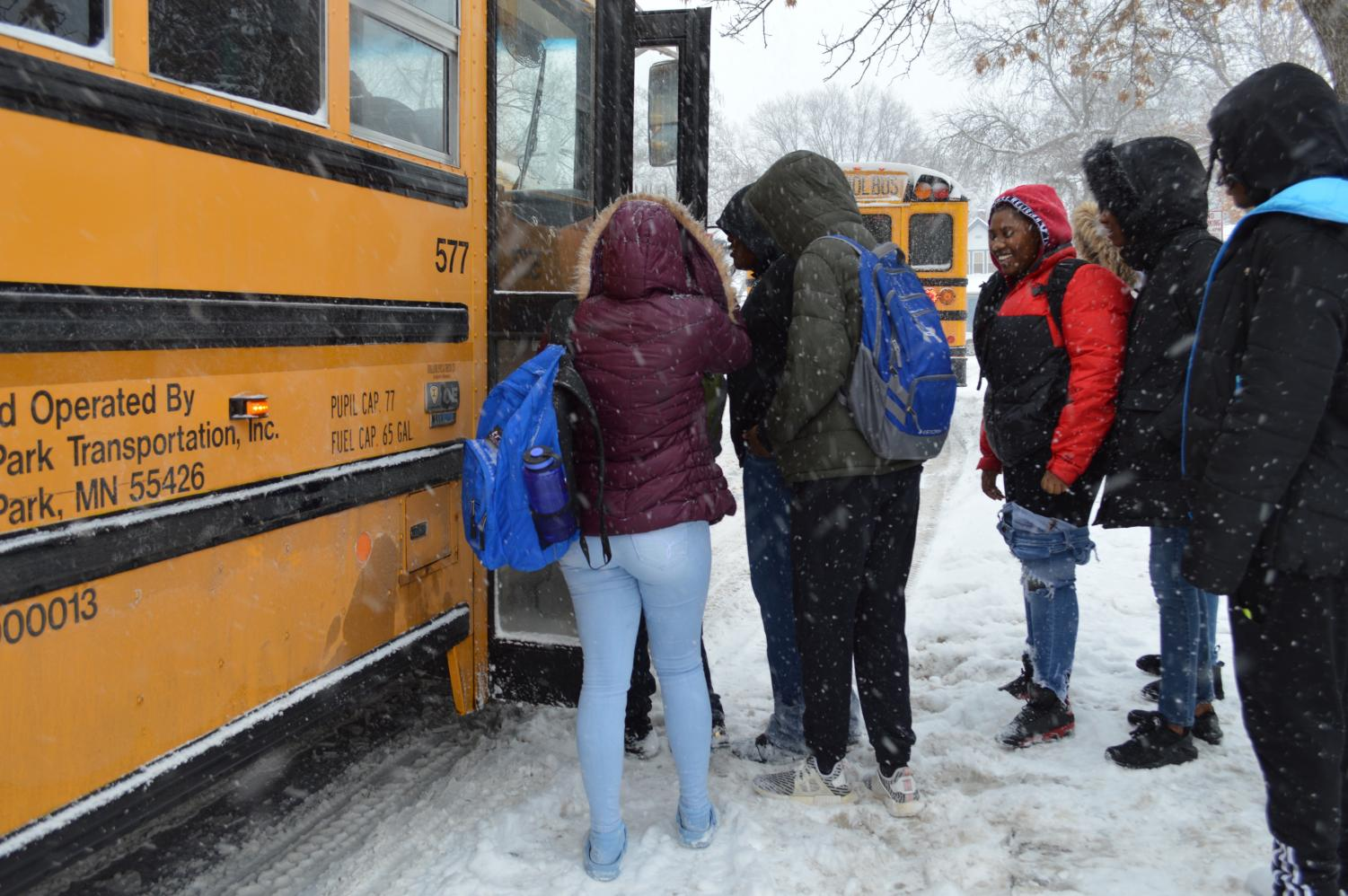 Students file into a school bus after the early dismissal at 2:10 p.m. Feb. 7. Park schools will have a two-hour late start Feb. 8 due to the forecasted winter weather.