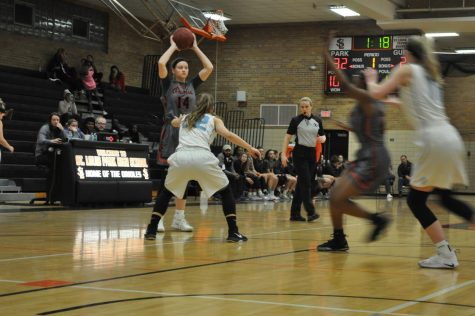 Girls' basketball captain joins 1000 point club