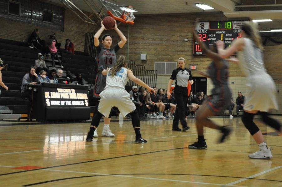 Senior+Lindsey+Olson+gets+ready+to+pass+the+ball+to+one+of+her+teammates.+Olson+reached+a+record+of+1000+points.+