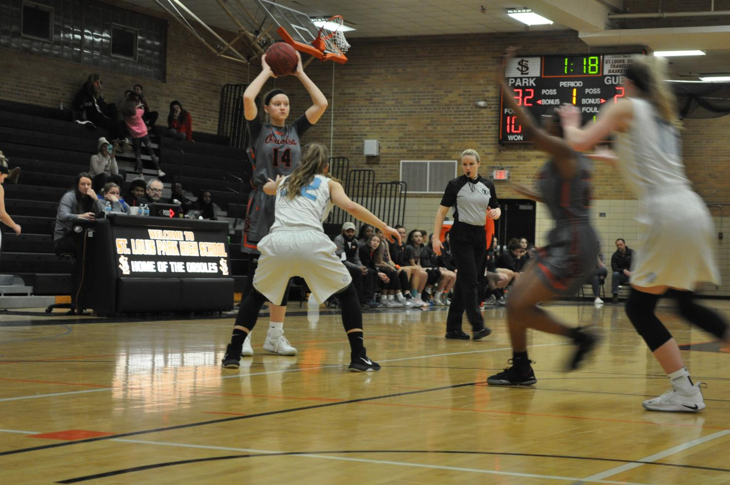 Senior Lindsey Olson gets ready to pass the ball to one of her teammates. Olson reached a record of 1000 points.
