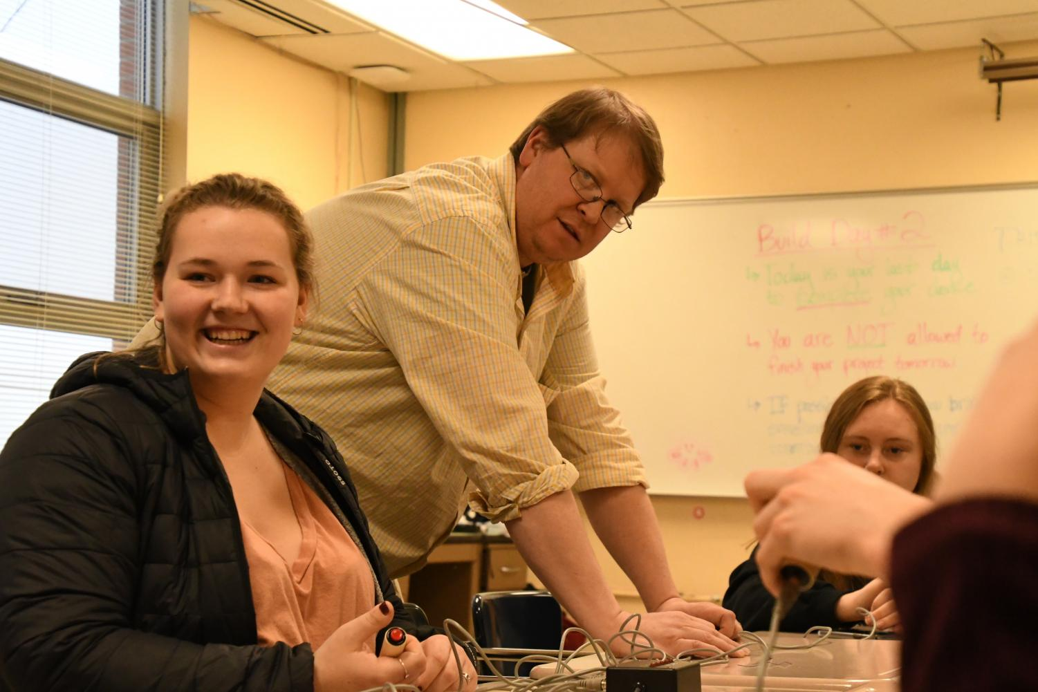 Senior Erica Dudley laughs with her fellow Quiz Bowl members during Quiz Bowl practice in preparation for Nationals.