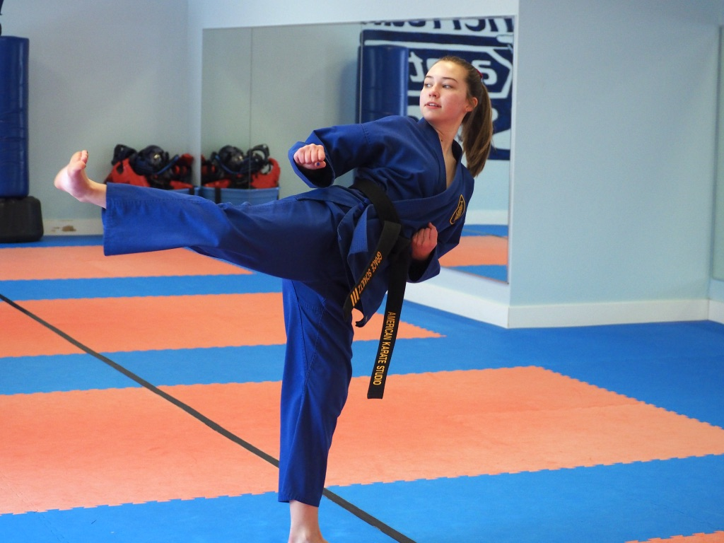 Sophomore Grace Schultz practices a side kick Feb. 10 on her own time. Schultz has a third-degree black belt and started taking karate lessons at age 5. She began teaching karate in February 2017.