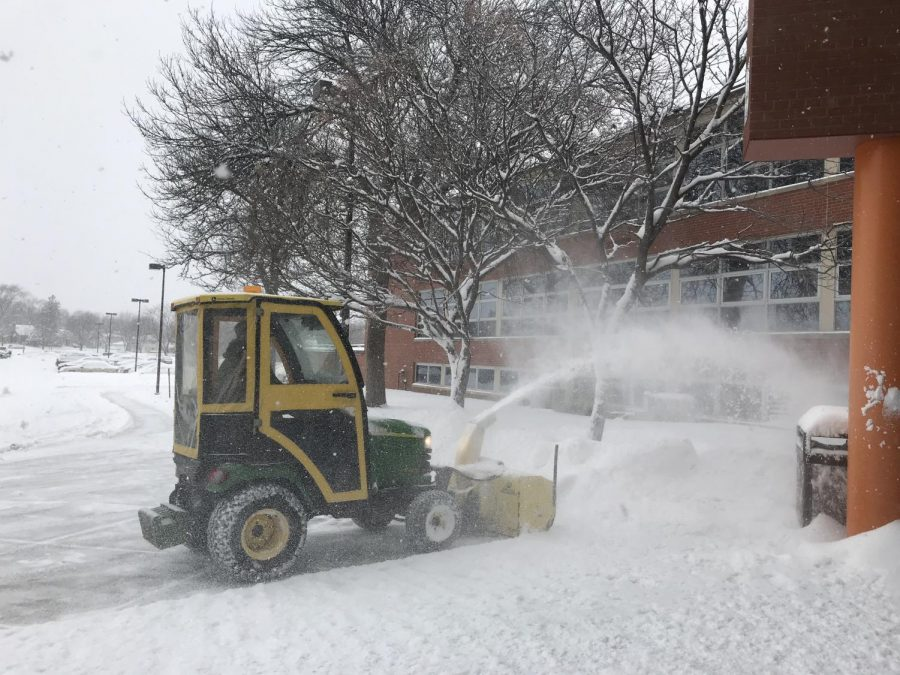 A+snow+blower+at+the+high+school+Feb.+7.+Students+will+be+released+one+hour+early+due+to+the+snow+conditions.