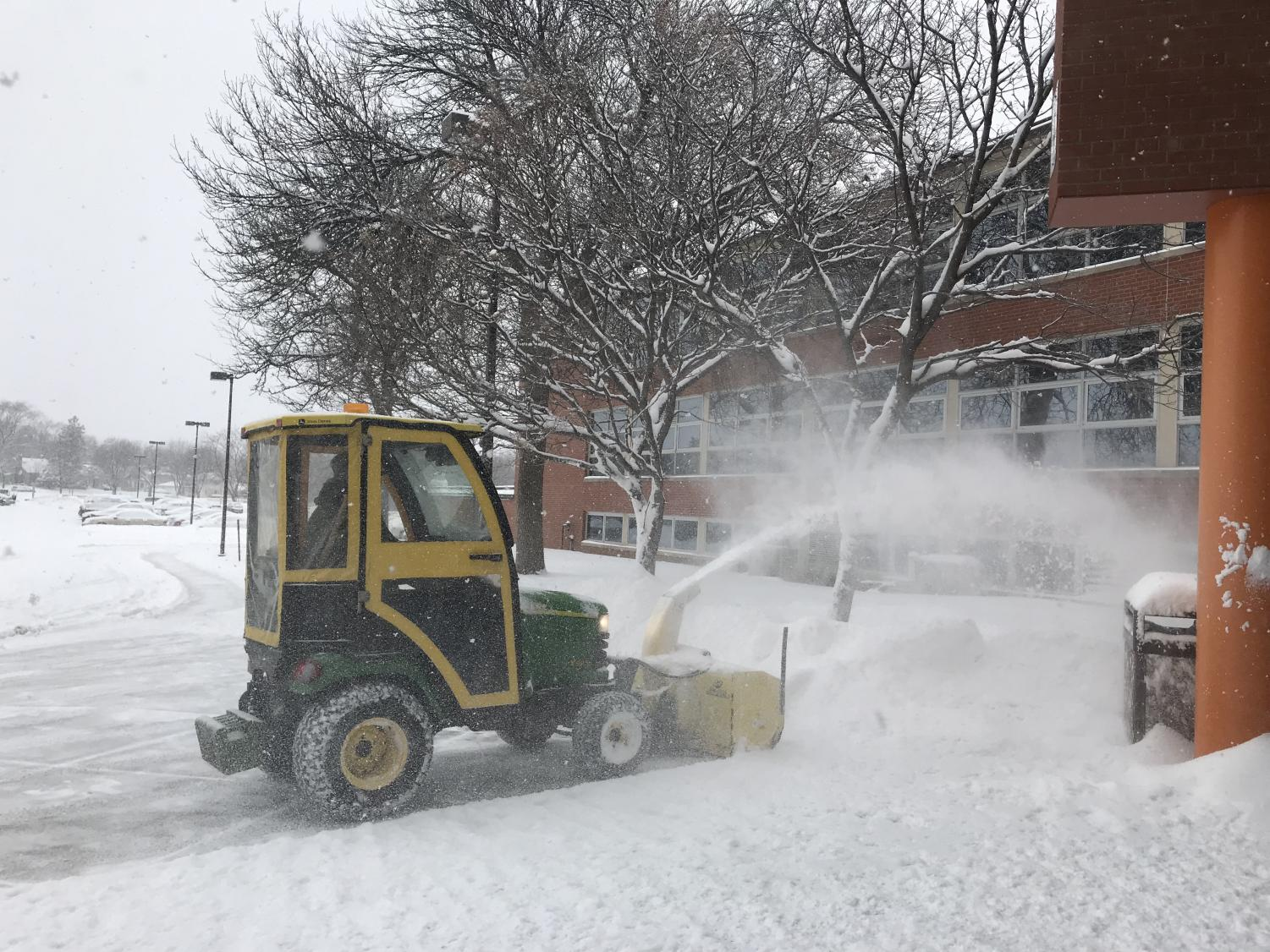 A snow blower at the high school Feb. 7. Students will be released one hour early due to the snow conditions.