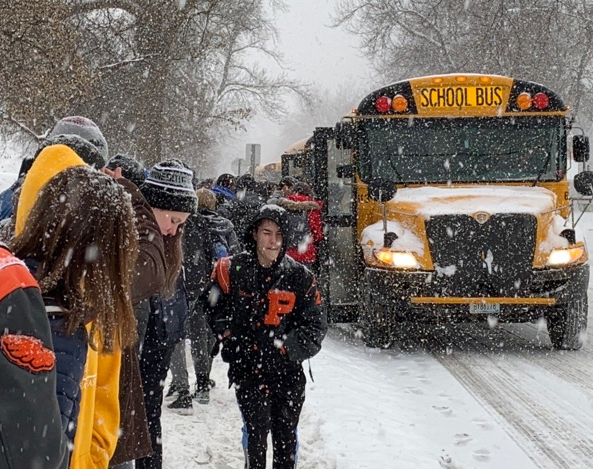 Students line up for the buses after their arrival 10 minutes late Feb. 5. According to an announcement over the loudspeaker at the high school, the snow conditions impacted transportation routes and caused some after school activities to be canceled.