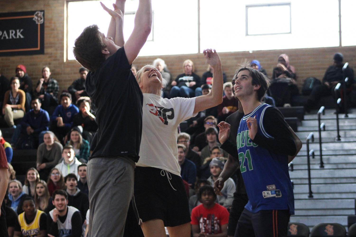 Counselor+Barb+Nelson+blocks+senior+John+Meyer+form+shooting+the+ball.+The+pep+fest+was+to+get+students+excited+for+the+following+weeks+activities.