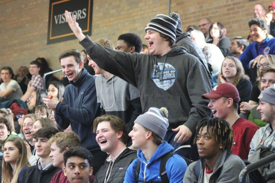 Senior Luke Boyum cheers in the stands for the student team after it scored. The  event is related to the first Sno Daze activity happening Feb. 19. The game will be a 3-on-3 basketball tournament at 7 p.m. in the Fieldhouse.