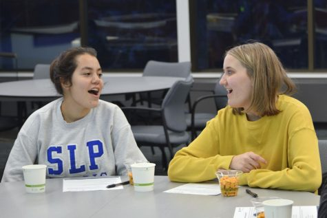 Juniors Maggie Klein and Amelia Ryan attend the Student Election Program meeting Feb. 12 at St. Louis Park City Hall. According to election specialist Robert Stokka, the program will have several meetings to explore different civic engagement topics.