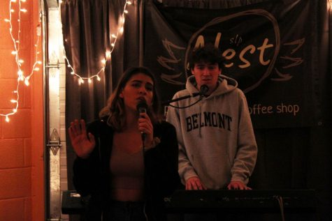 Seniors Ben Klepfer and Andreina Rodriguez perform at the Battle of the Bands Sno Daze event hosted at the Nest Feb. 21.
