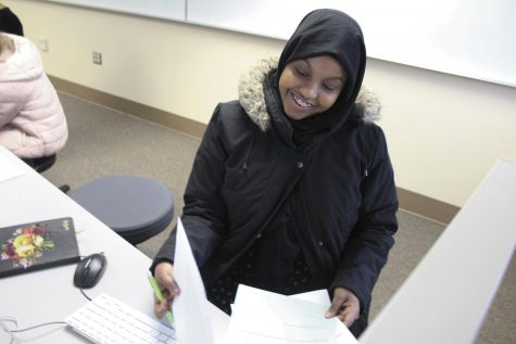 Junior Ayan Ali works on a packet during her IB English SL class Feb. 11 in C153. She was able to complete additional English credits by taking elective credits at her school in Somalia that are required credits at Park.