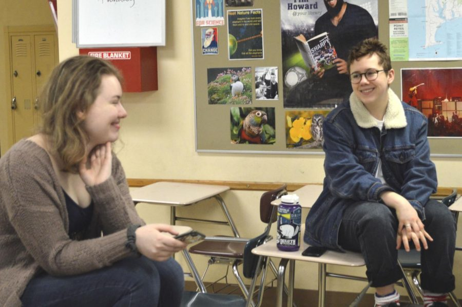Senior Roots and Shoots leader Katie Christiansen and sophomore member Zoe Frank discuss the clubs upcoming residential and business outreach plans during a meeting Feb. 5. According to Frank, Roots and Shoots meets on Tuesdays.