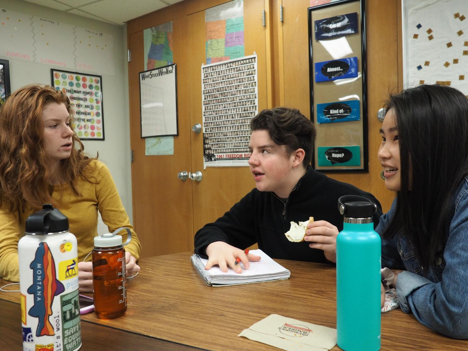 Sophomore Student Council members Isaac Scott, Grace Fahey and Li Livdahl discuss ideas for the upcoming Sno Daze week. Student Council leads activites every day leading up to the dance Feb. 23.