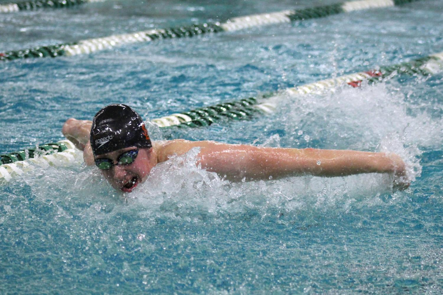 Senior+Luke+Anderson+takes+a+breath+during+100m+butterfly+race.+Anderson+is+a+part+of+the+200m+Medley+Park+relay+that+qualified+for+State.+