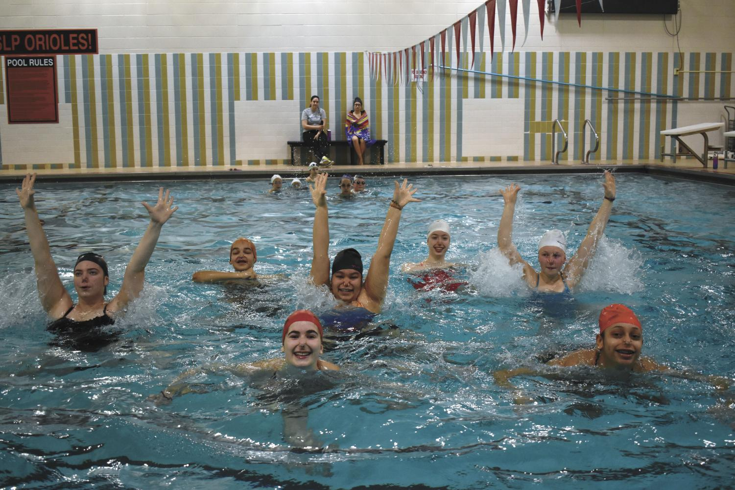 Sophomores Maya Lee and Bella Stewart and team practice one of their routines at the middle school Feb. 2. Synchronized swimming is unable to practice at the high school due to construction around the locker rooms.