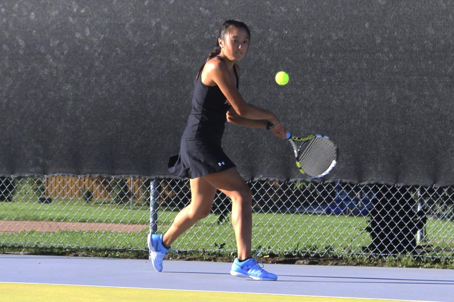 During the 2018-2019 tennis season, senior Susanna Hu returns a serve at a home match. Hu verbally committed to play Division 3 tennis at the University of Wisconsin La Crosse in February.