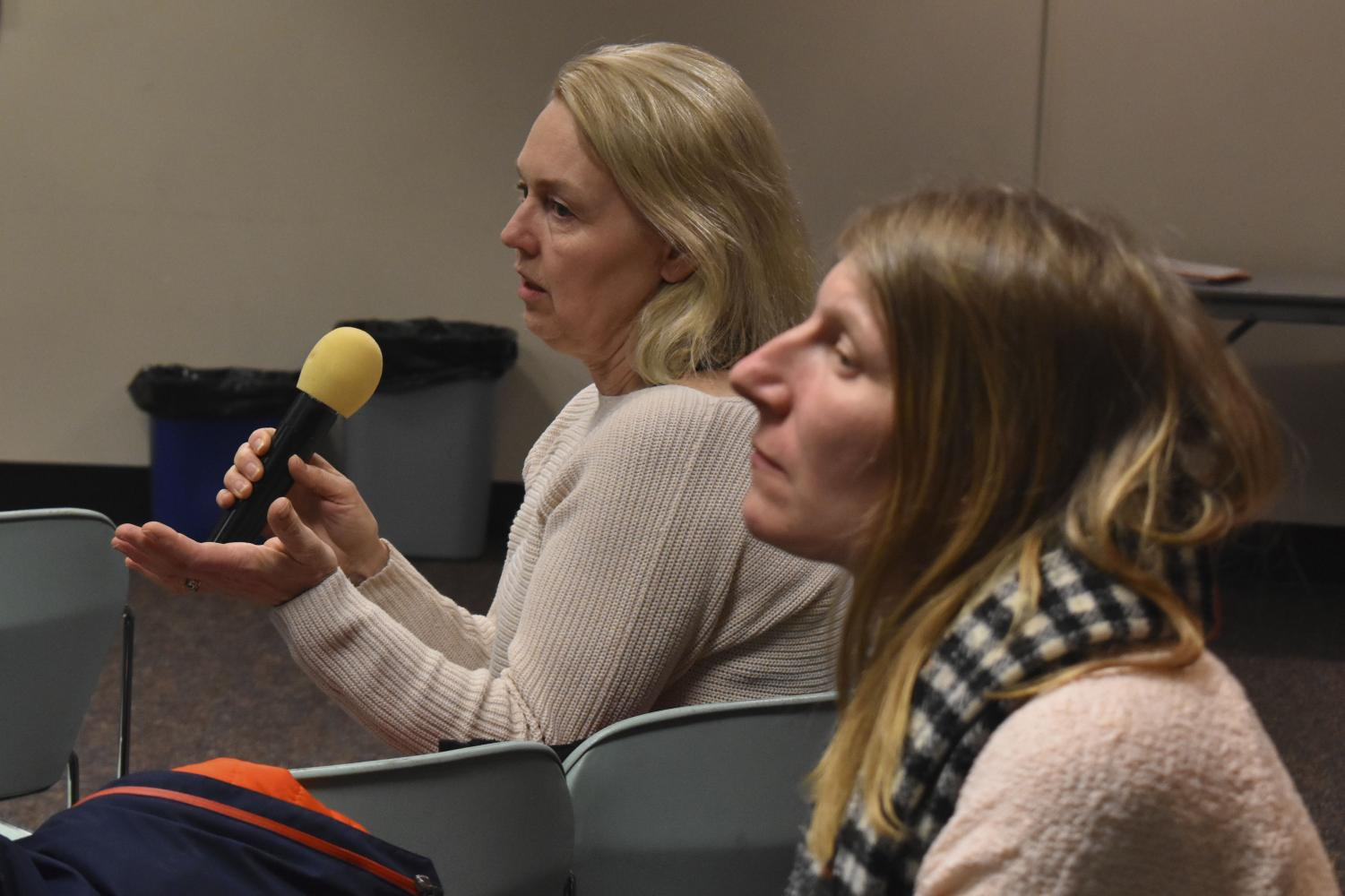 A St. Louis Park parent asks a question regarding the time change for schools in the St. Louis Park School District during an informational meeting Feb. 21. According to superintendent Astein Osei, the school board will likely make the final decision in March.