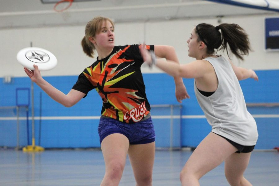 Senior Grace Hamond throws disc to teammate at girls' ultimate first scrimmage of the season against Hopkins. The scrimmage Feb. 26 took place at Hopkins Junior High. Hopkins defeated Park with an undefined score.