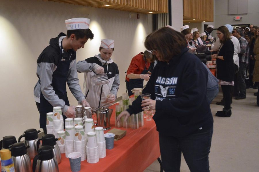 Senior Will Staib helps out during Empty Bowls Feb. 28 at Westwood Lutheran Church. Co-chair Lisa Hertel said the large attendance numbers were surprising.