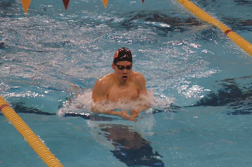 Sophomore Hayden Zheng warms up before he swims the 100 breaststroke at the AA boys' swimming State meet March 5 at the University of Minnesota.